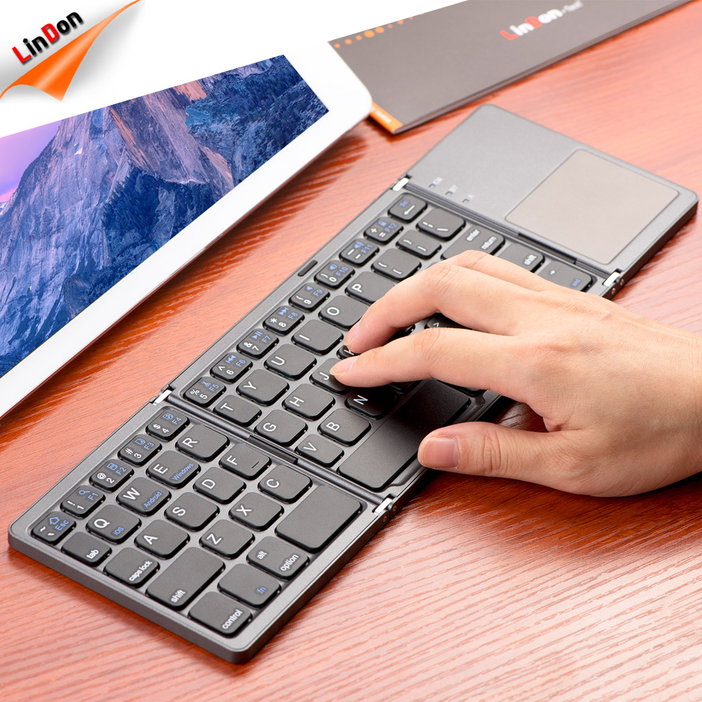 Newest Portable Mini Wireless Keyboard With Touchpad Mouse Foldable Keyboard For Laptop