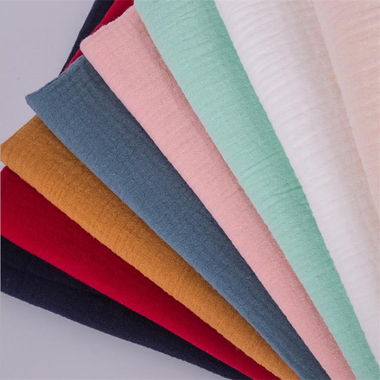 在庫綿 100% ダブルクレープ生地純粋な綿ガーゼの質感クレープ綿アート子供服スカーフ生地多色