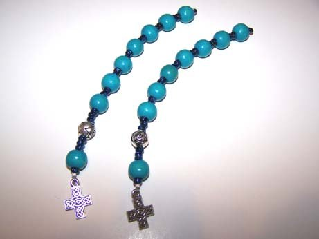 Turquoise wooden bead pocket rosary with silver celtic cross.