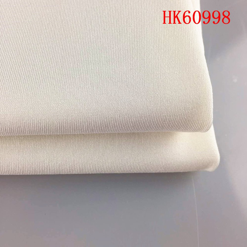 Wujiang textile solid color 100% polyester 4 way stretch knit fabric for clothing