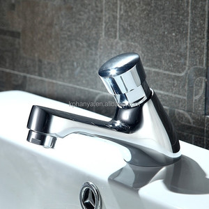 Hot sell new design brass chrome time delay pillar deck basin faucet