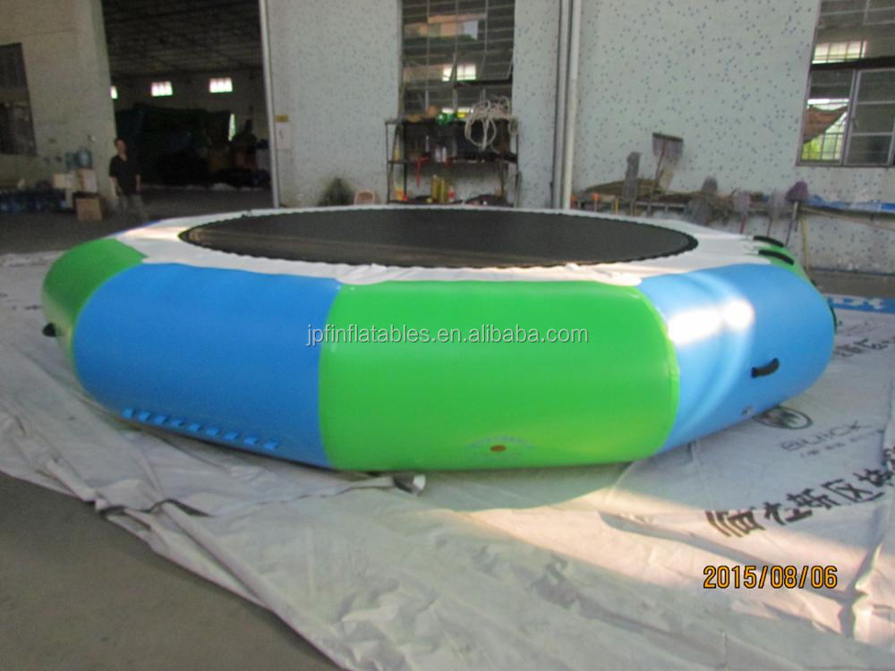 Blue and green inflatable water trampoline with elastic, lake jumping trampoline for sale