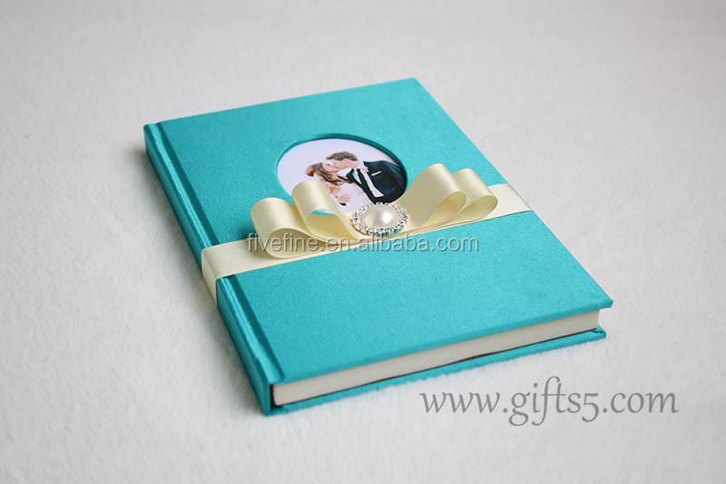 Unique wedding guest book with ribbon bow