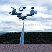 Blue tree wind kinetic sculpture by the sea