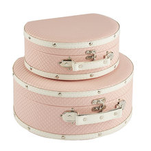 Decorative storage vintage style small pink leather suitcase