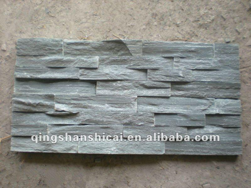 Grigio ardesia impilati pietra piastrelle muro di mattoni