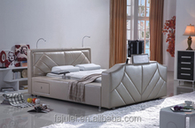 queen size leather bed with tv in the footboard