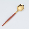 gold red spoon