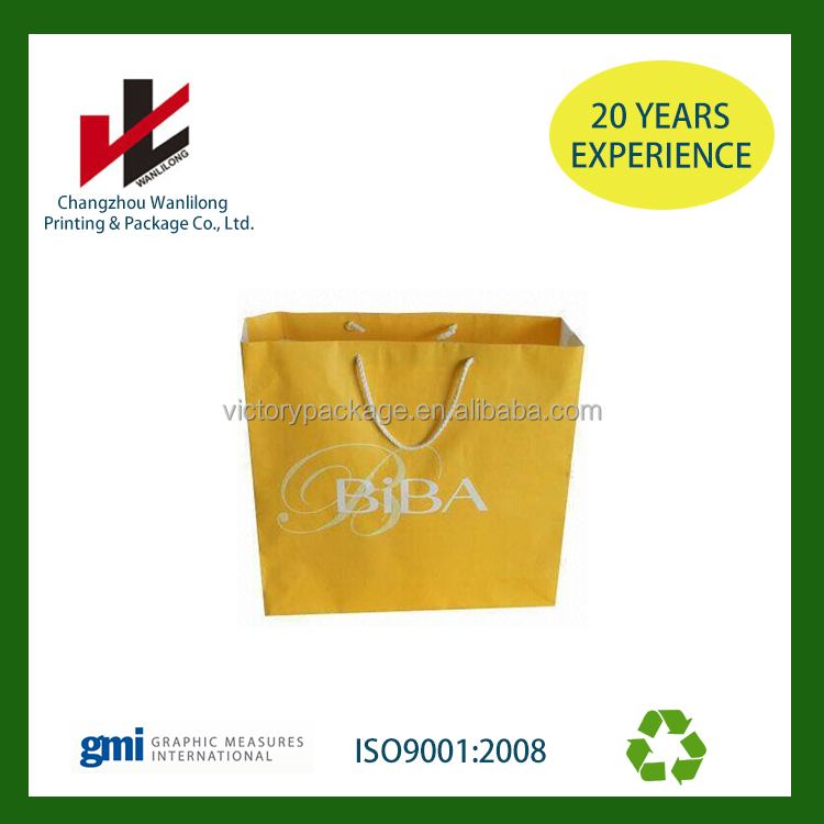 Custom printed yellow kraft paper bag with handle made in china