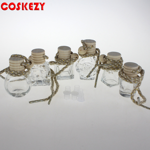 Wholesale 4ml Hanging Car Perfume Bottles clear perfume glass bottle with wooden cap bottle sale well