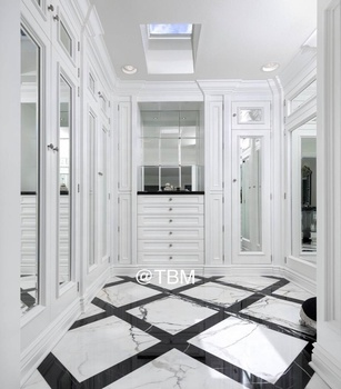 Traditional white closet with mirror doors