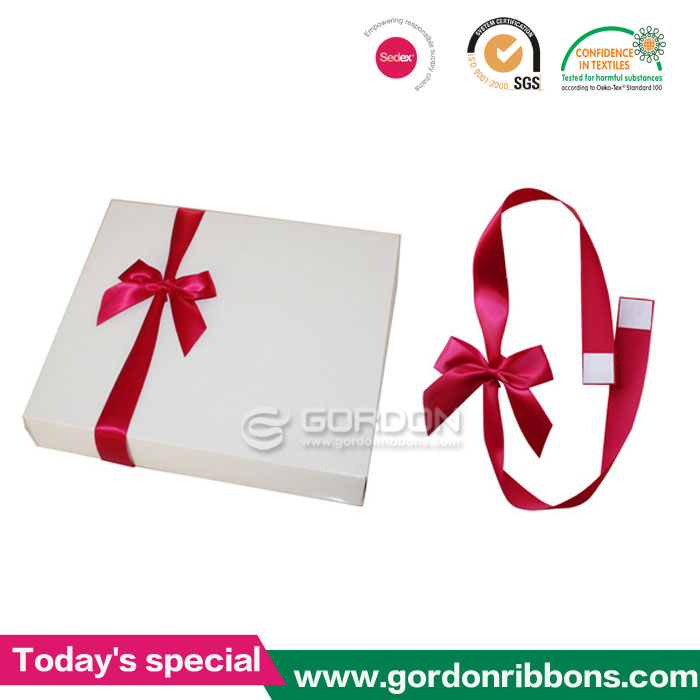 Double faced adhesive tape on satin ribbon
