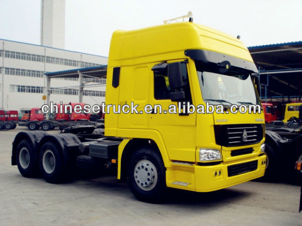 Lowest price howo tractor truck 6*4 3 36HP hot sale