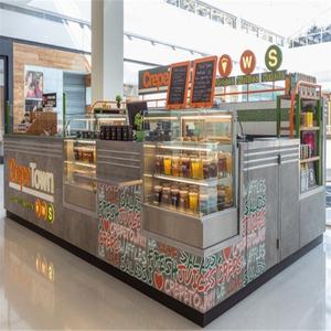 juice / coffee / milk / tea / cookie / bread kiosk or booth or cart
