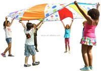 Kids play parachute