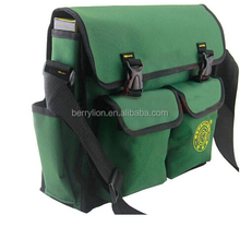 Green color tool bag for plumbers, electrician with good sawing technique