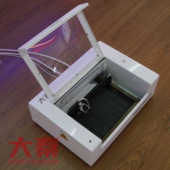 Mobile screen guard tempered glass cutting machine with raw material for screen protector