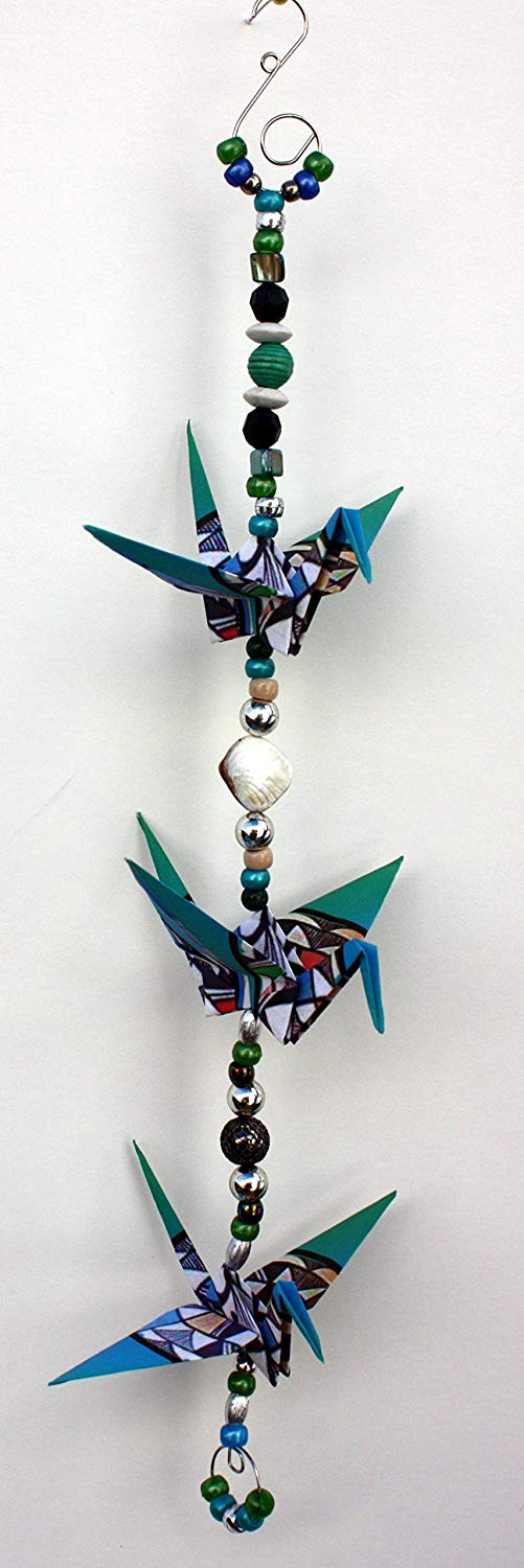 """Good Luck"" Southwestern Kokopeli design crane mobile for indoor decor. approx. 18"" height and 5.5"" wide. A unique handmade origami accent piece."