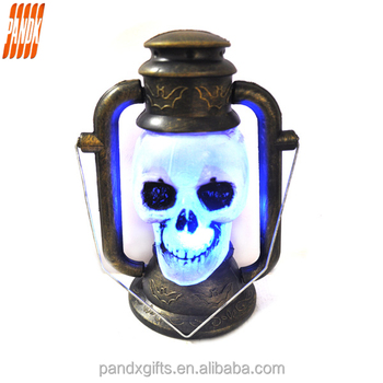 Halloween hand skull the lantern with colorful led towns with empty eyes have handle skull