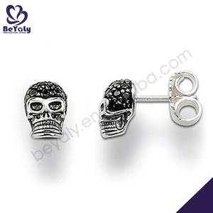 Graceful black onyx silver skull earrings for men