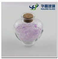High quality 350ml heart shape candy glass jar unique shaped glass bottles with cork for wishing wholesale