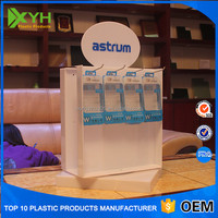 Manufacture acrylic table top cell phone accessory rotating counter display