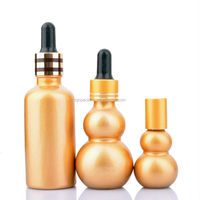 Gold And Silver Painted Gourd Shape Glass Dropper Serum Bottle For Essential Oil
