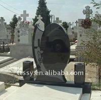 black granite monument with cross