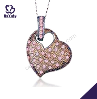 Charming pink stone silver heart with wings necklace