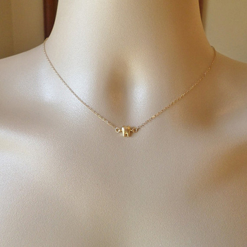 store pendant necklace tiny bullet gold