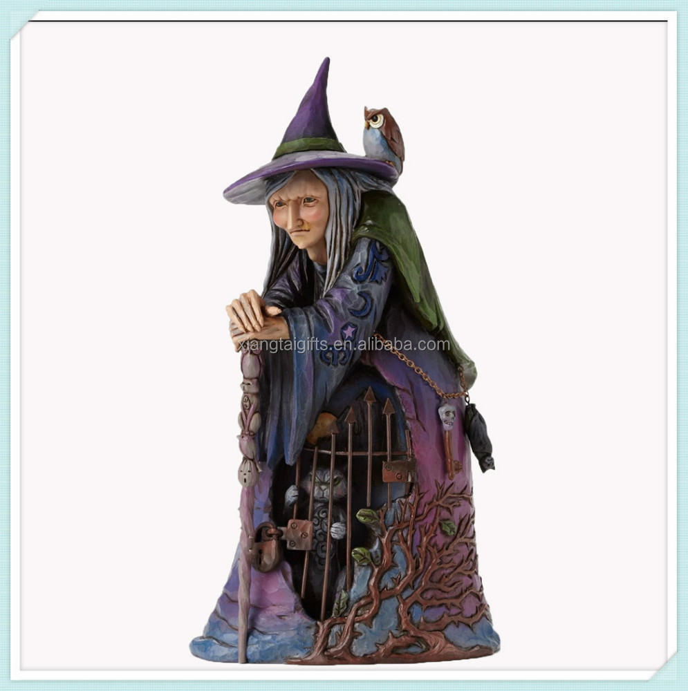 Halloween Wiccan witch with cat behind gate