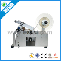 Semi-automatic labeling machine for round bottles ; Glass and PE bottle label applicator