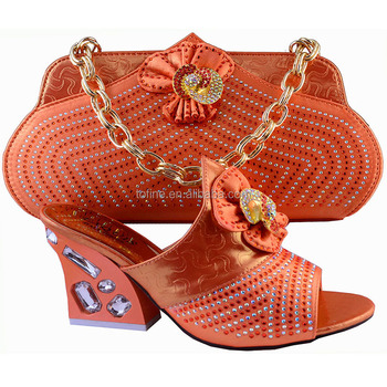 Elegant women orange shoes and matching bag set for wedding party