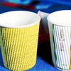 disposable yellow ribbed paper coffee cup plain