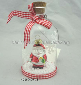 Christmas ornament santa in clear glass bottle with wood lid and stopper