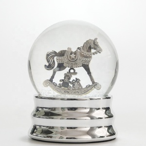 Customizable low cost snow globe with blowing snow