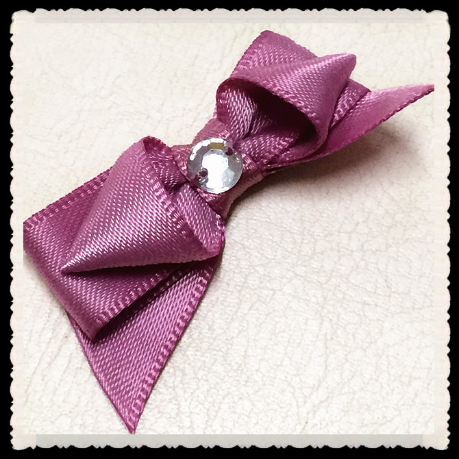 classical purple ribbon bow with diamond