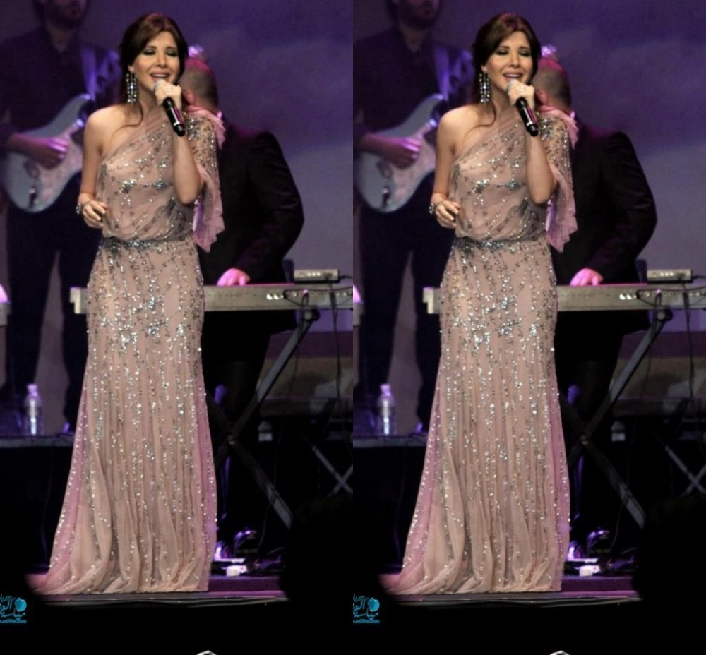 2015 Elegant Arabic Dubai Celebrity Lebanese Nancy Ajram Evening Dresses Mermaid Champagne Bead Crystals Prom Party Formal Gowns