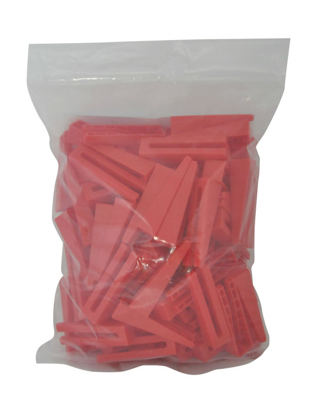 Reusable hard plastic wedge spacers