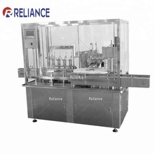 Reliance RVF 1 Oz CBD Oil Amber glass dropper bottle filling capping machine