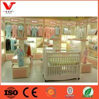 Supply high end custom clothing shop slatwall design floor standing display for kids
