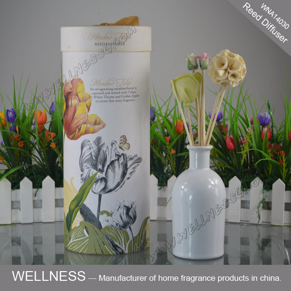 reed diffuser in ceramic bottle with natural sticks and flowers