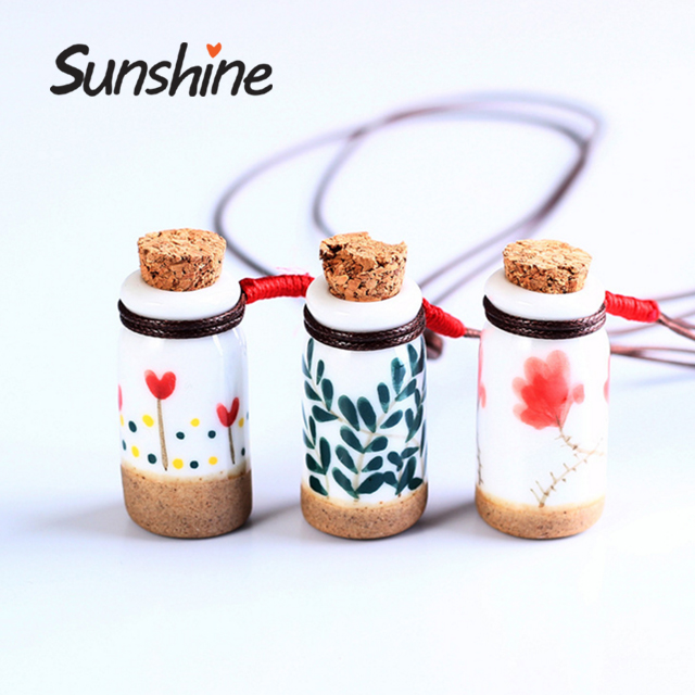 Decorative hanging small ceramic perfume bottle