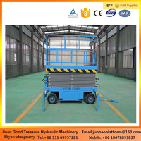 Four wheels mobile hydraulic scissor lift platform with low price