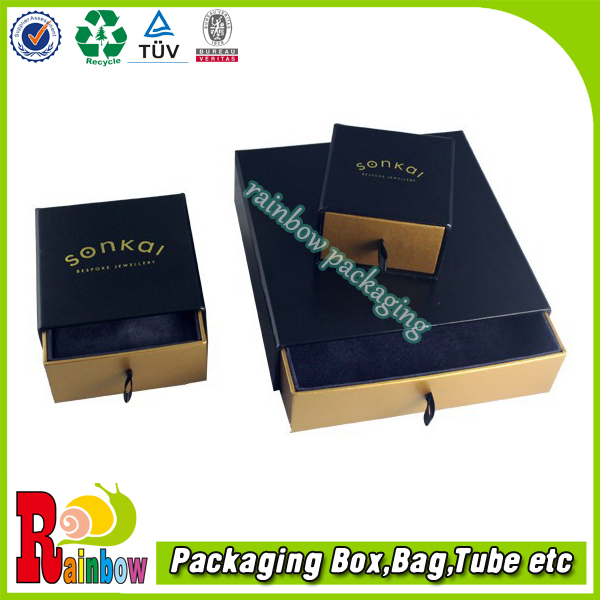 paper boxes with slide out drawer and ribbon tab pull coated and gold card material