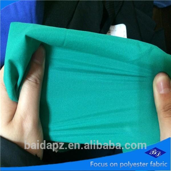 ad0853a9bd7e Fabricante de alta qualidade 100% poliéster spandex liso de uniforme/calças  material