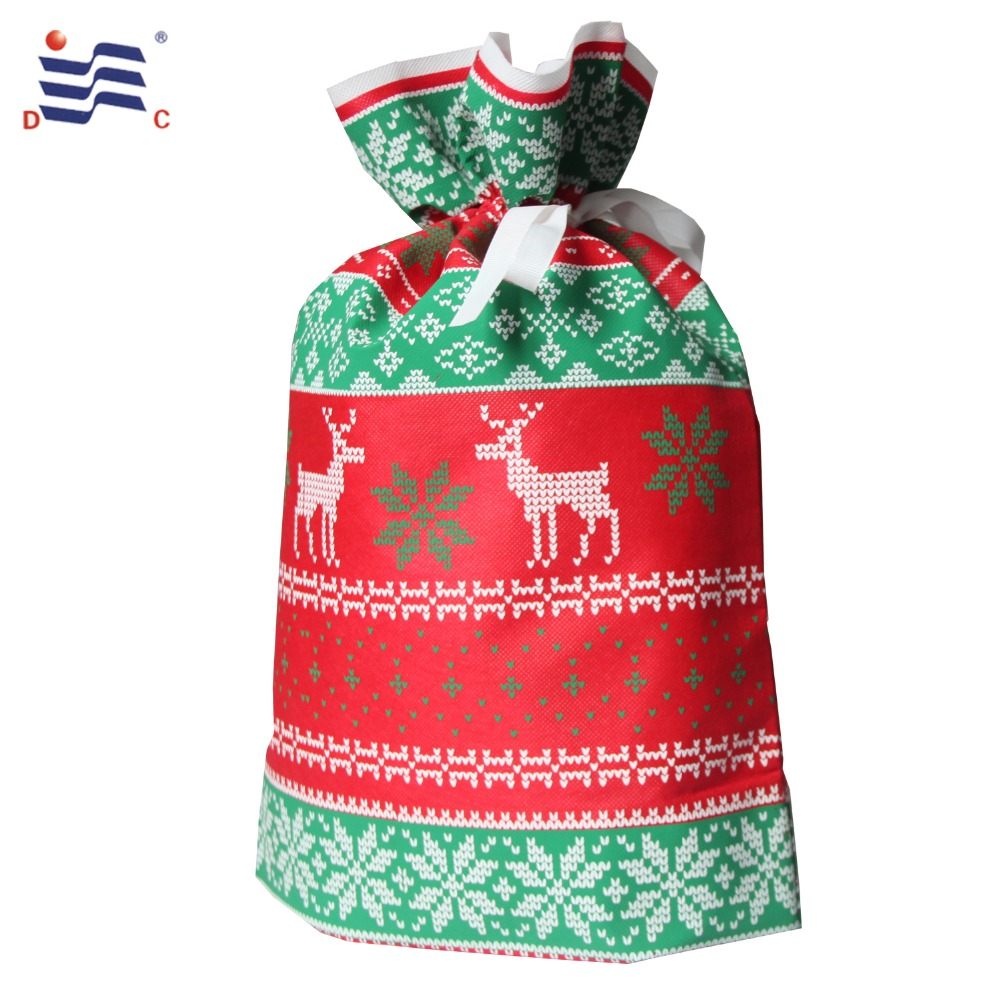 Silk screen non woven christmas drawstring gift bag with grosgrain ribbon