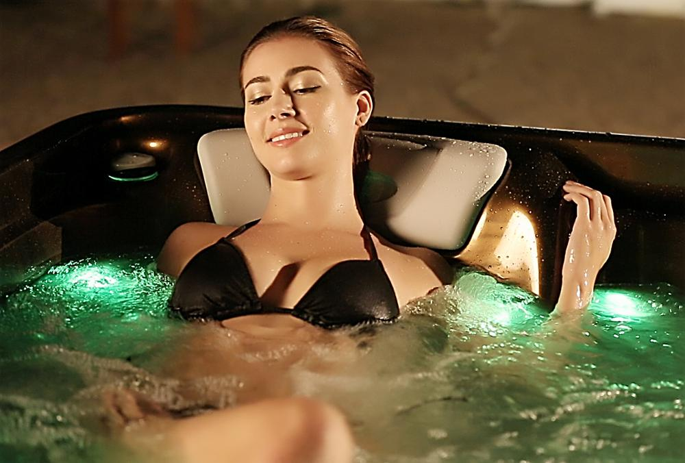 Girl s hits in a hot tub