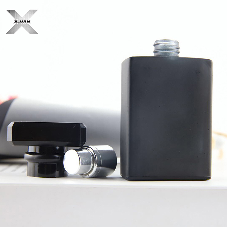 China factory custom 30ml black plastic top press cap glass tube bottle perfume