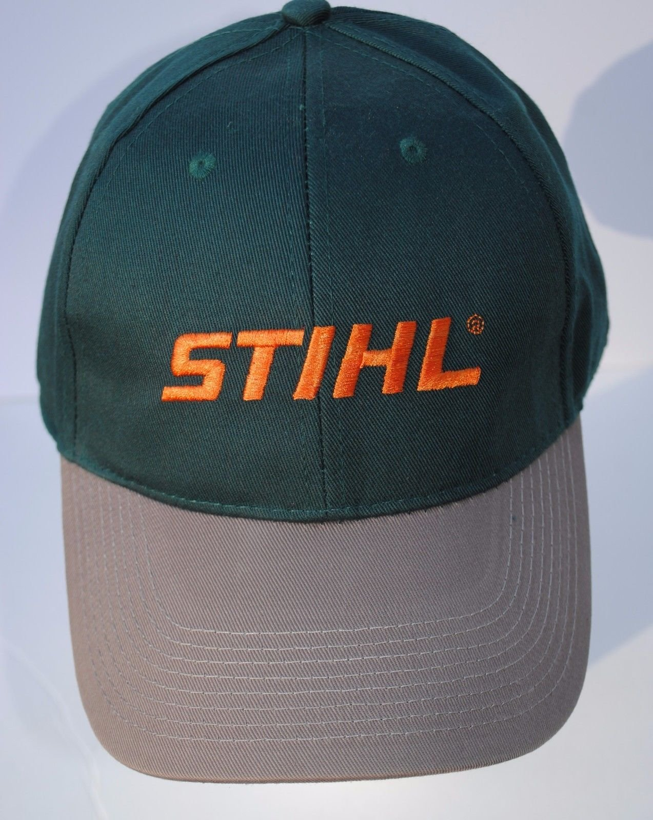 90d473a33e7 Get Quotations · Stihl Forest Green Fabric Hat   Cap With Orange Embroidered  Stihl Logo